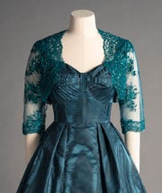 This Michele Clapton dress replicates one worn by Queen Elizabeth to a private dinner.