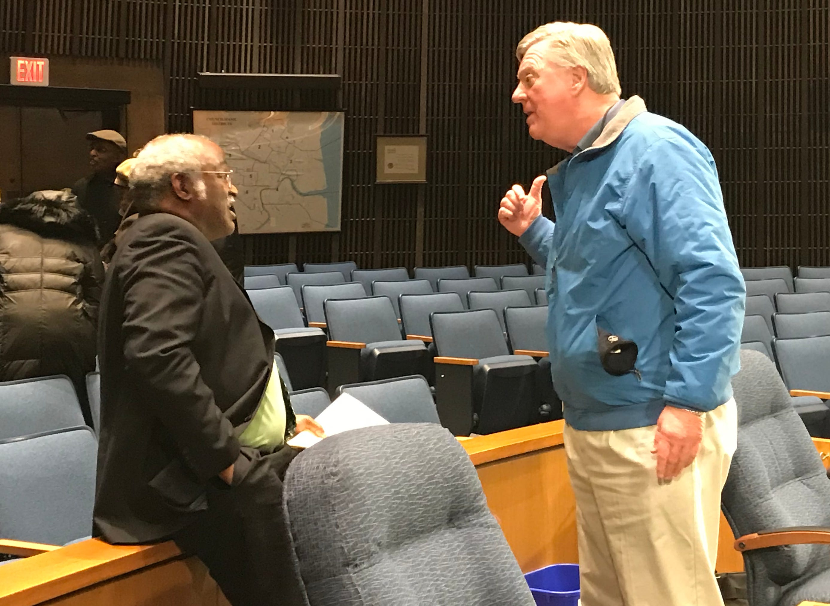 Councilmen Sam Guy and Bud Freel argue after a contentious Wilmington City Council meeting.