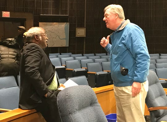 Councilmen Sam Guy and Bud Freel argue after a contentious Wilmington City Council meeting Wednesday night over the vacant 1st District seat.