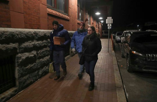 A group of volunteers, including Scott Siegel (left) and Maddie Brooks of Christiana Care (right) and Stephen Metraux of the University of Delaware's School of Public Policy and Administration, head into the Joseph R. Biden Jr. Railroad Station in Wilmington as they look for homeless people while performing a count and survey as temperatures drop to the single digits Wednesday night.