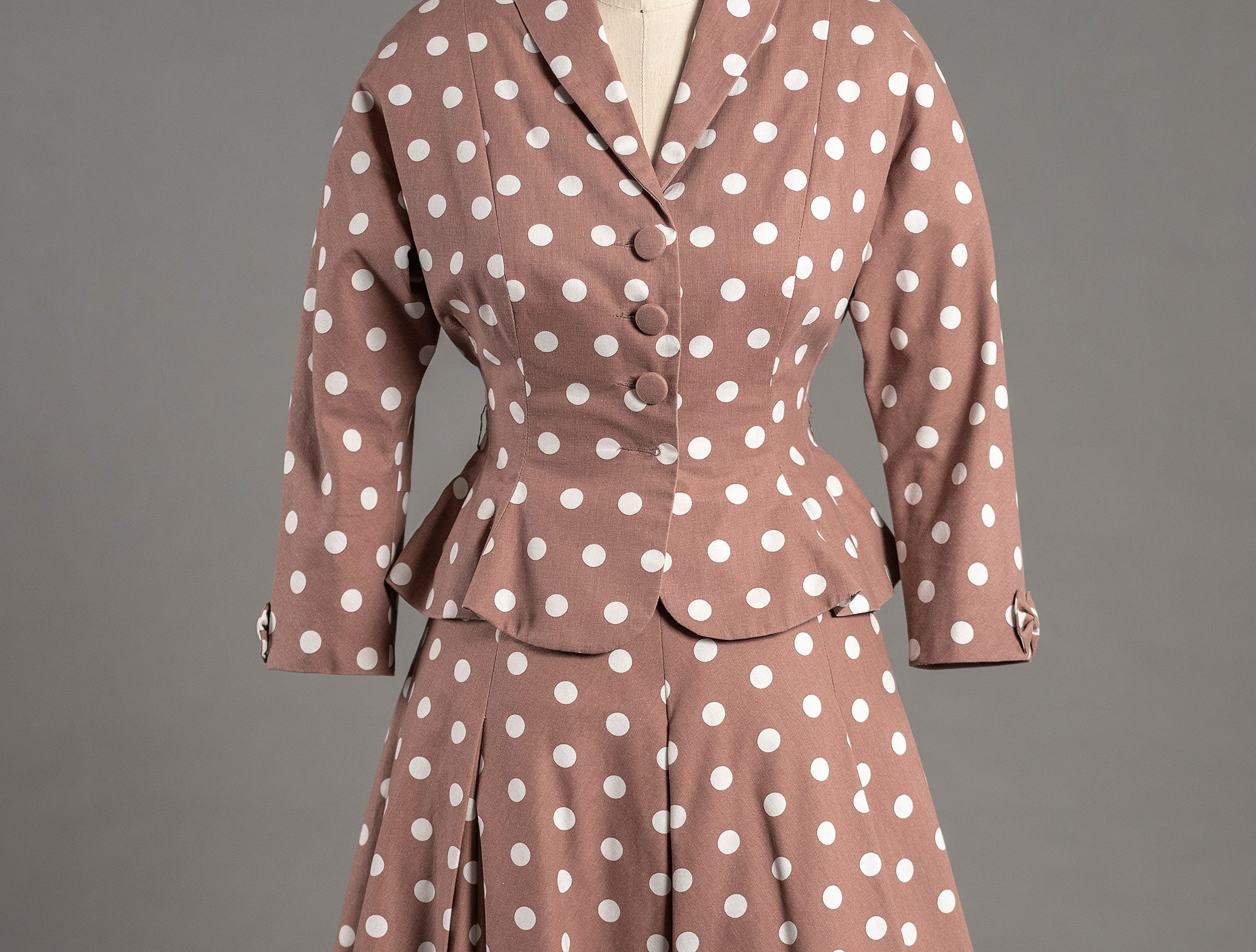 Michele Clapton designed this polka-dotted suit for Claire Foy's Princess Elizabeth to wear while visiting Kenya in 1952 in 'The Crown.'