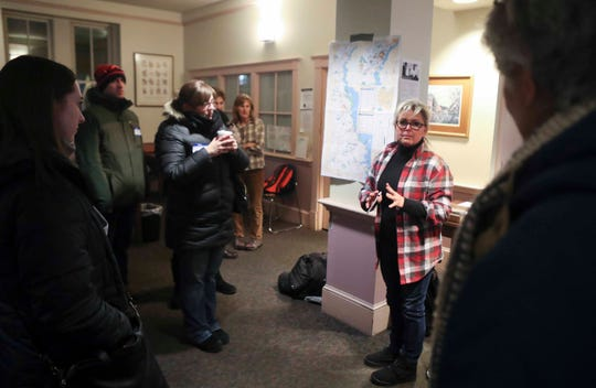 Volunteer are prepped by Housing Alliance Delaware Director Tina Showalter before heading into the single-digit temperatures to perform surveys and a count of the area's homeless population Wednesday.