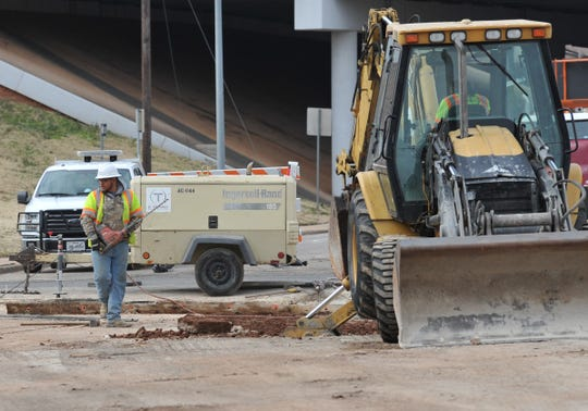 A construction crew works to remove concrete from the Broad at 6th Street intersection Thursday morning.