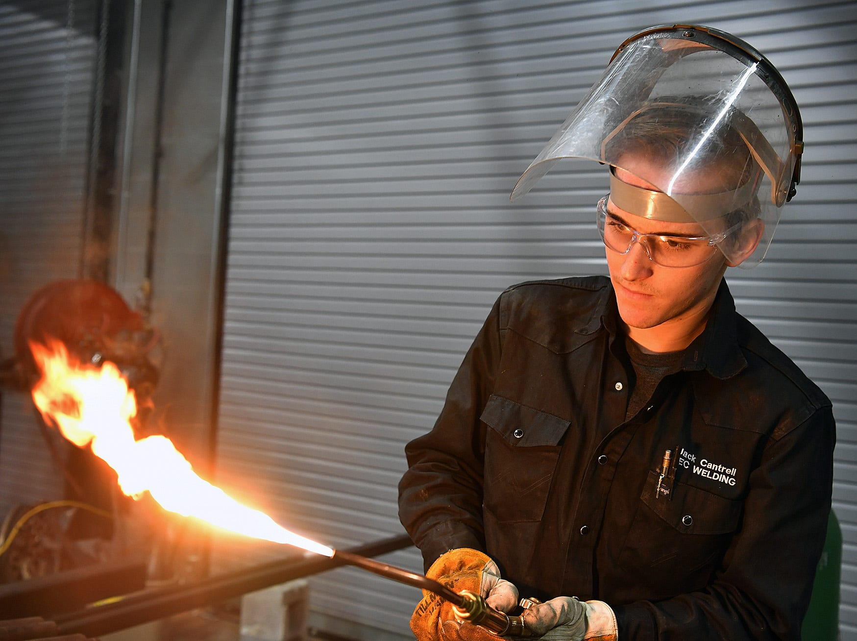 Jack Cantrell, a welding student at the Career Education Center, fires up a torch to work on on a brass sculpture he's creating for the Skills USA competition in Waco, Texas February 22.