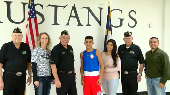 McNiel Middle School student Emmanuel Carrillo teams up with local chapter 41 of the DAV to promote patriotism as he prepares to fight in Fort Worth and then to Reno, Nevada. He is the current USA Boxing National Junior Olympic Champion. Left to right: Robert French, Principle Summer Bynum, Cmdr. Jimenez, Champion Emmanuel Carrillo, Daisey Carrillo, Larry Main and Emmanuel Carrillo. Boxing Champion Carrillo stated that he will be fighting for the ones that fought for our freedom and he thanks the DAV for supporting him.