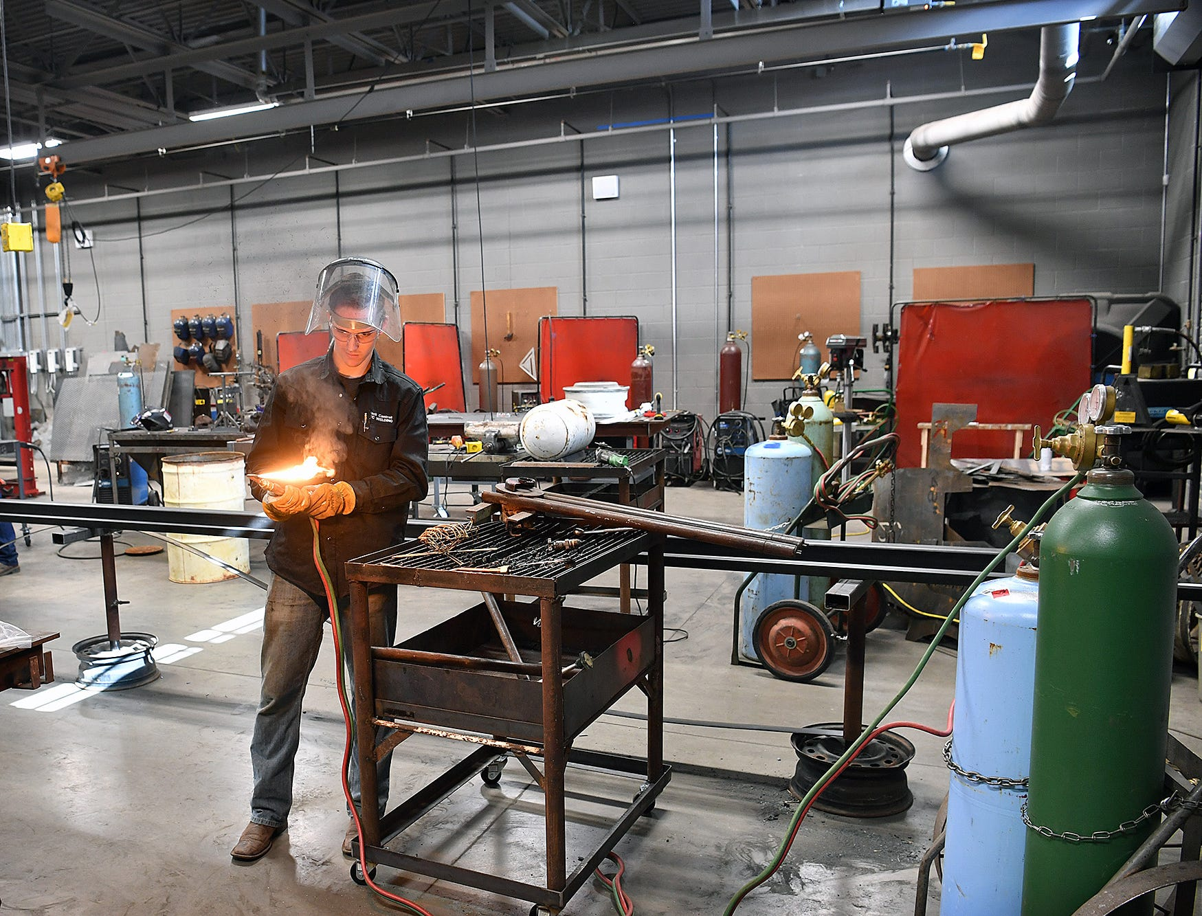 Jack Cantrell fires up a torch in the Welding Technology class at the Career Education Center.