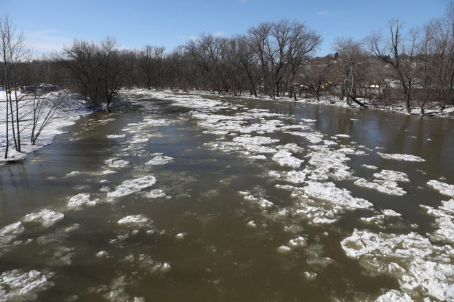 Ice floats down the Tuscarawas River near its confluence with the Walhonding in Coshocton on Thursday.