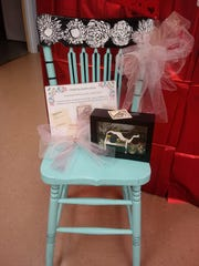 This entry features items painted by local artists. The chair was painted by Sandy Booth and the shadow box was painted by Susan Stubbins.