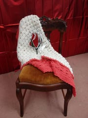 Peggy Murphy donated this vintage chair for the fourth annual auction that benefits Eastside Community Ministry.