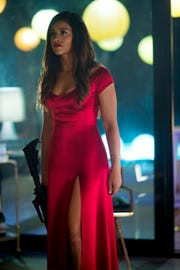"Gina Rodriguez is a fashionable action figure in the thriller ""Miss Bala."""
