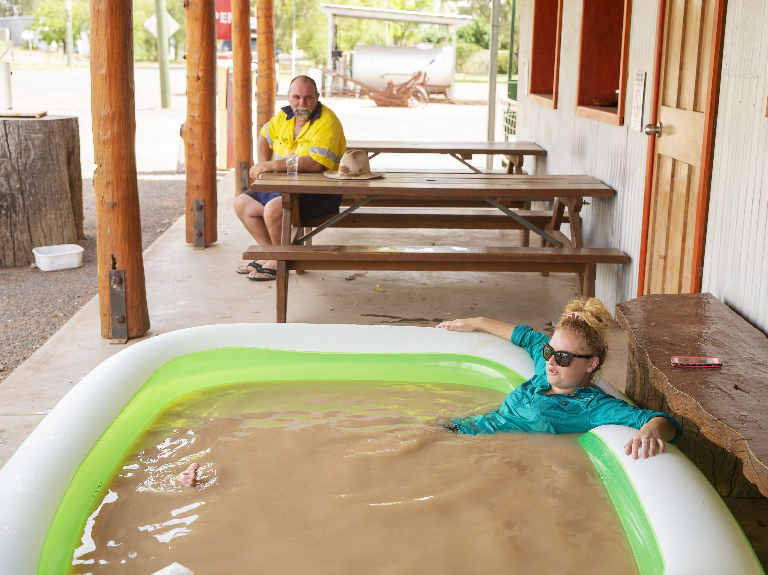 Jasmin Kew relaxes in a blow up pool full of muddy tap water from the Darling River in 116.6 degree heat outside of Shindy's Inn on Jan. 17, 2019 in Louth, Australia. Local communities in the Darling River area are facing drought and clean water shortages as debate grows over the alleged mismanagement of the Murray-Darling Basin. Recent mass kills of hundreds of thousands of fish in the Darling river have raised serious questions about the way WaterNSW is managing the lakes system, and calls for a royal commission.