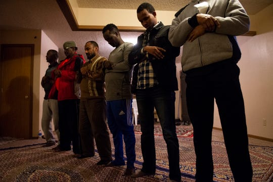 Somali refugees pray in an apartment that has been turned into a mosque at the Garden Spot Apartments  Jan. 23, 2019.