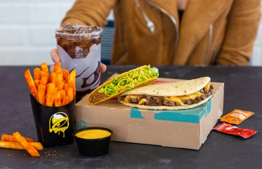 The $7 Double Steak Melt Deluxe Box, available at Taco Bell restaurants in  Cleveland, has a flatbread with double serving of steak and cheese, Nacho Fries, two Crunchy Tacos, and a medium drink all for $7. The Double Steak Melt is also available a la carte for $3.49