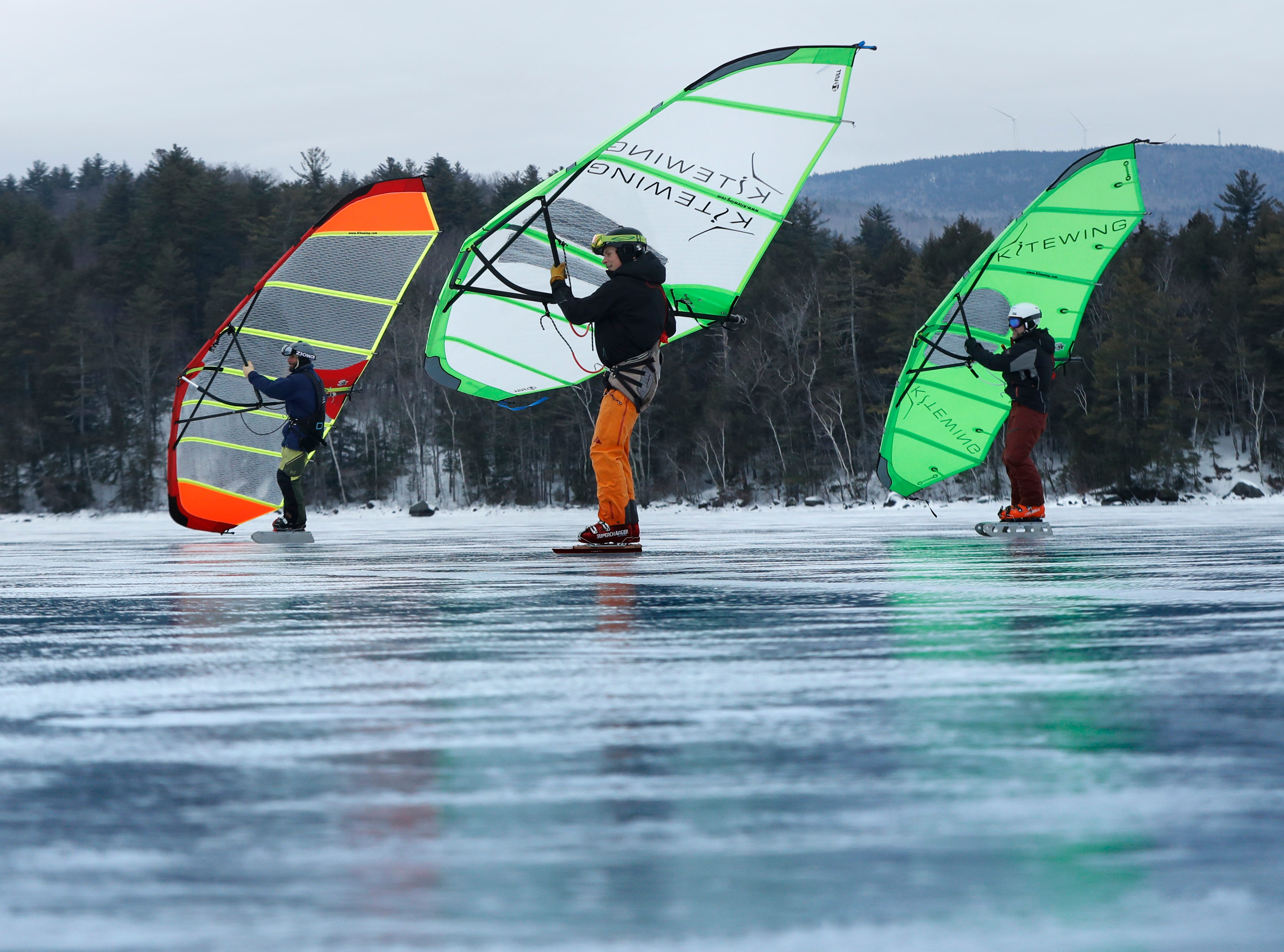 "Kitewing sailors travel on Newfound Lake, Sunday, Jan. 27, 2019, in Hebron, N.H. ""New Hampshire lakes have the best ice,"" said rider Martin Kimbel. ""There's no reason to go anywhere else."""