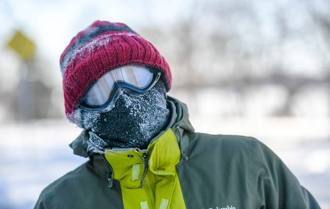 Steven Willy of Minneapolis bundled up for a mile walk in the sub-zero temperatures in Minneapolis, Jan. 2019.