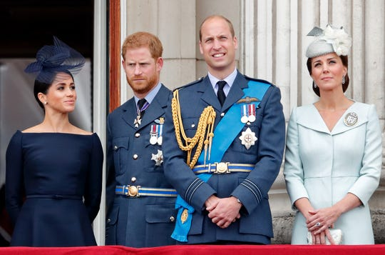 Duchess Meghan of Sussex, Prince Harry, Prince William and Duchess Kate of Cambridge mark the centenary of the Royal Air Force from the balcony of Buckingham Palace on July 10, 2018.