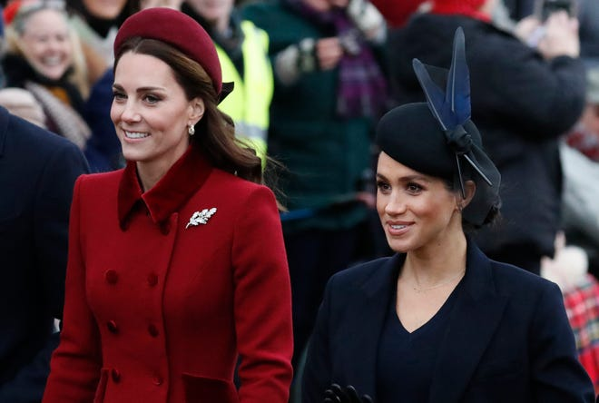 Are these two feuding? Duchess Kate of Cambridge and Duchess Meghan of Sussex look happy together as they walk to church on Dec. 25, 2018, at Sandringham.