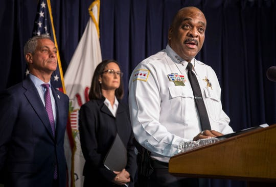 In this Aug. 29, 2018 file photo, Chicago Police Superintendent Eddie Johnson, accompanied by Illinois Attorney General Lisa Madigan, center, and Chicago Mayor Rahm Emanuel, speaks at a news conference in Chicago.