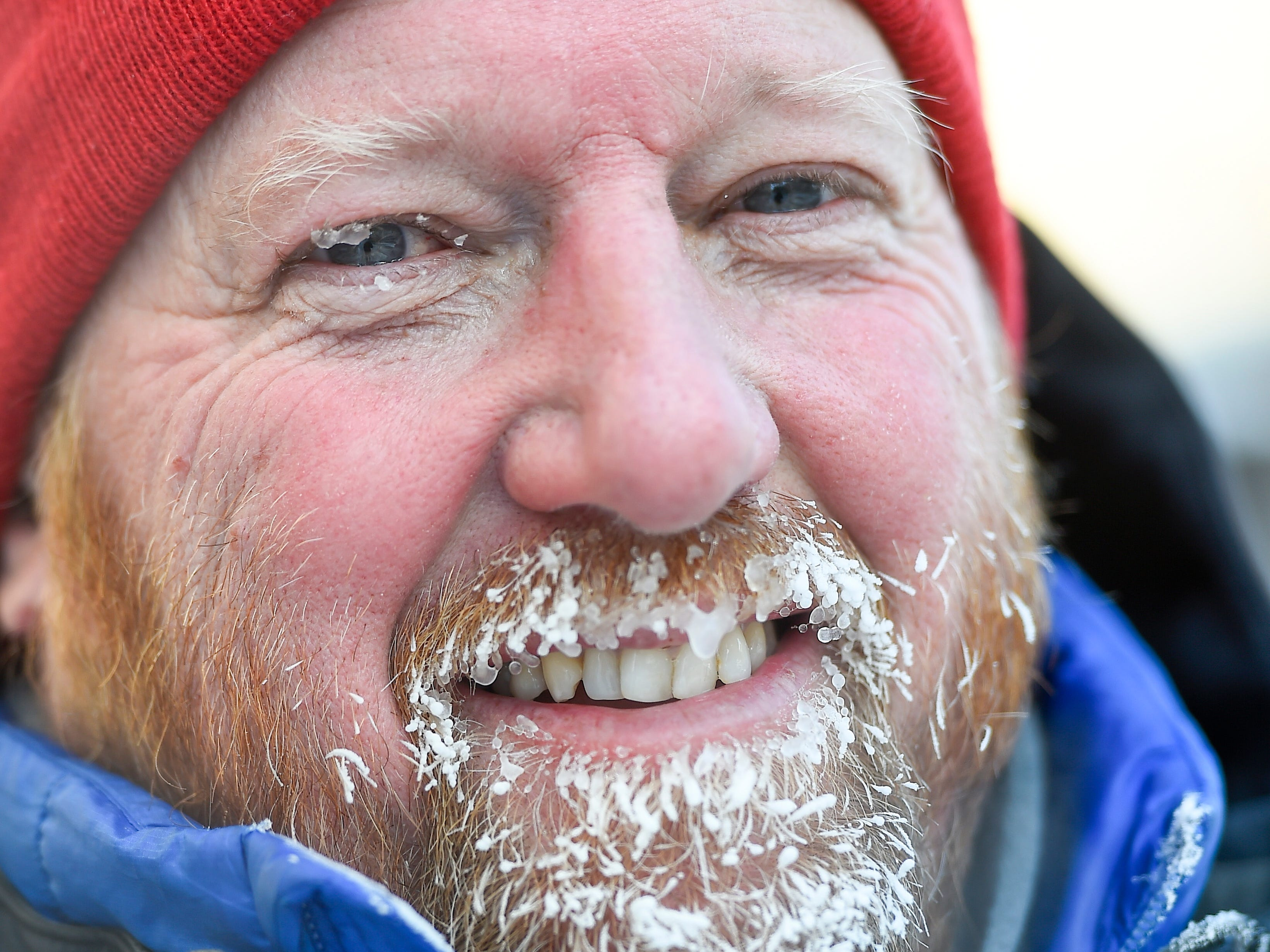 Chuck Carpenter of Minneapolis is frost covered as he goes for a walk in the in the sub-zero temperatures in Minneapolis, Jan.  2019.