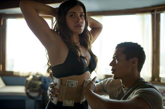 "Lino (Ismael Cruz Cordova) forces Gloria (Gina Rodriguez) into a criminal operation in ""Miss Bala."""