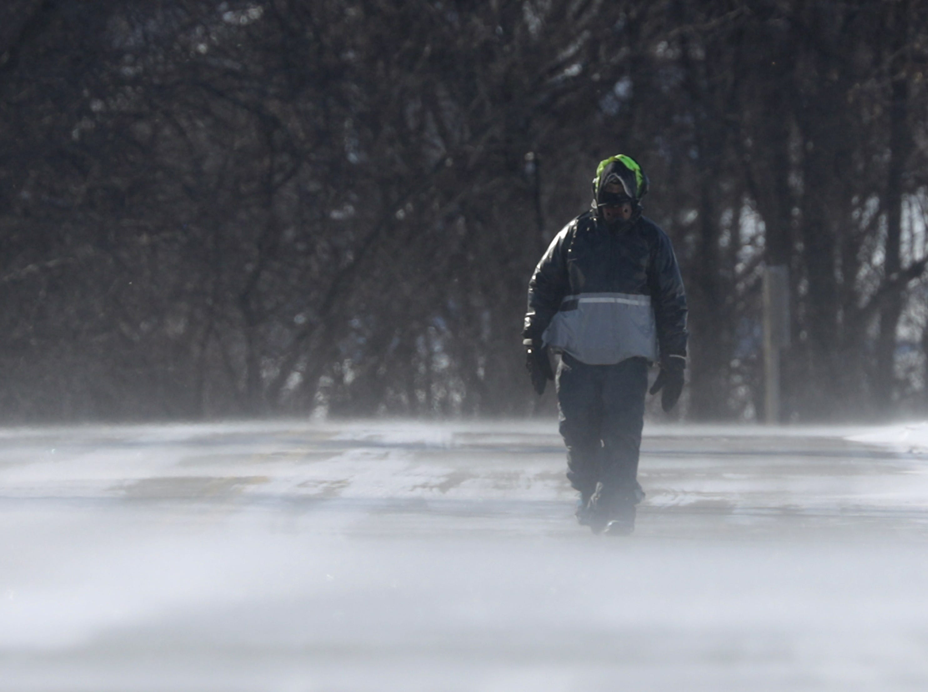 Dick Raab walks near High Cliff state Park during a polar vortex that brought extremely cold temperatures and dangerous wind chill temperatures on Wednesday, Jan. 30, 2019, in Sherwood, Wis.