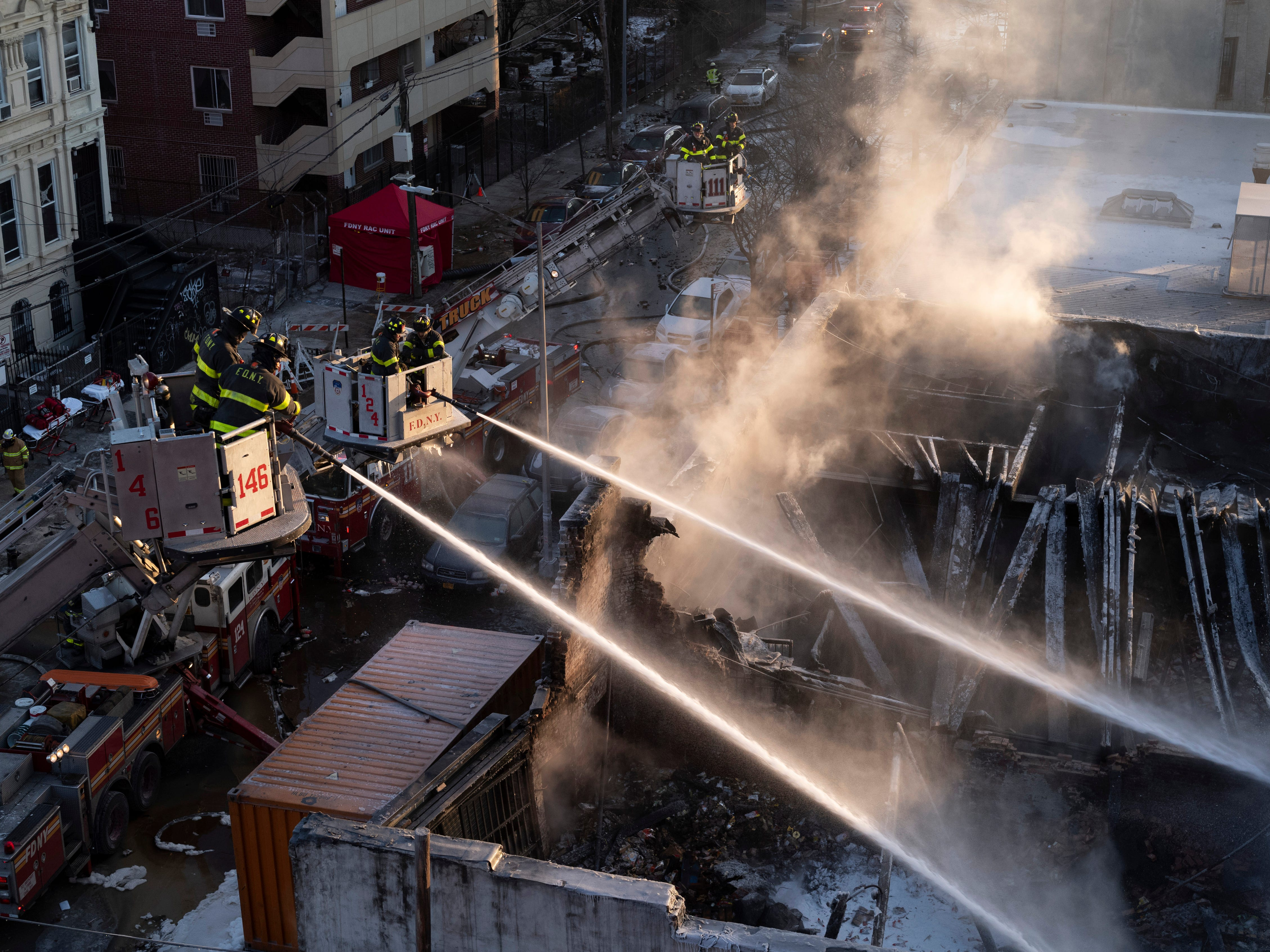 New York firefighters battle a blaze in a commercial building in the Bedford Stuyvesant neighborhood of Brooklyn, Jan. 31, 2019 in New York.