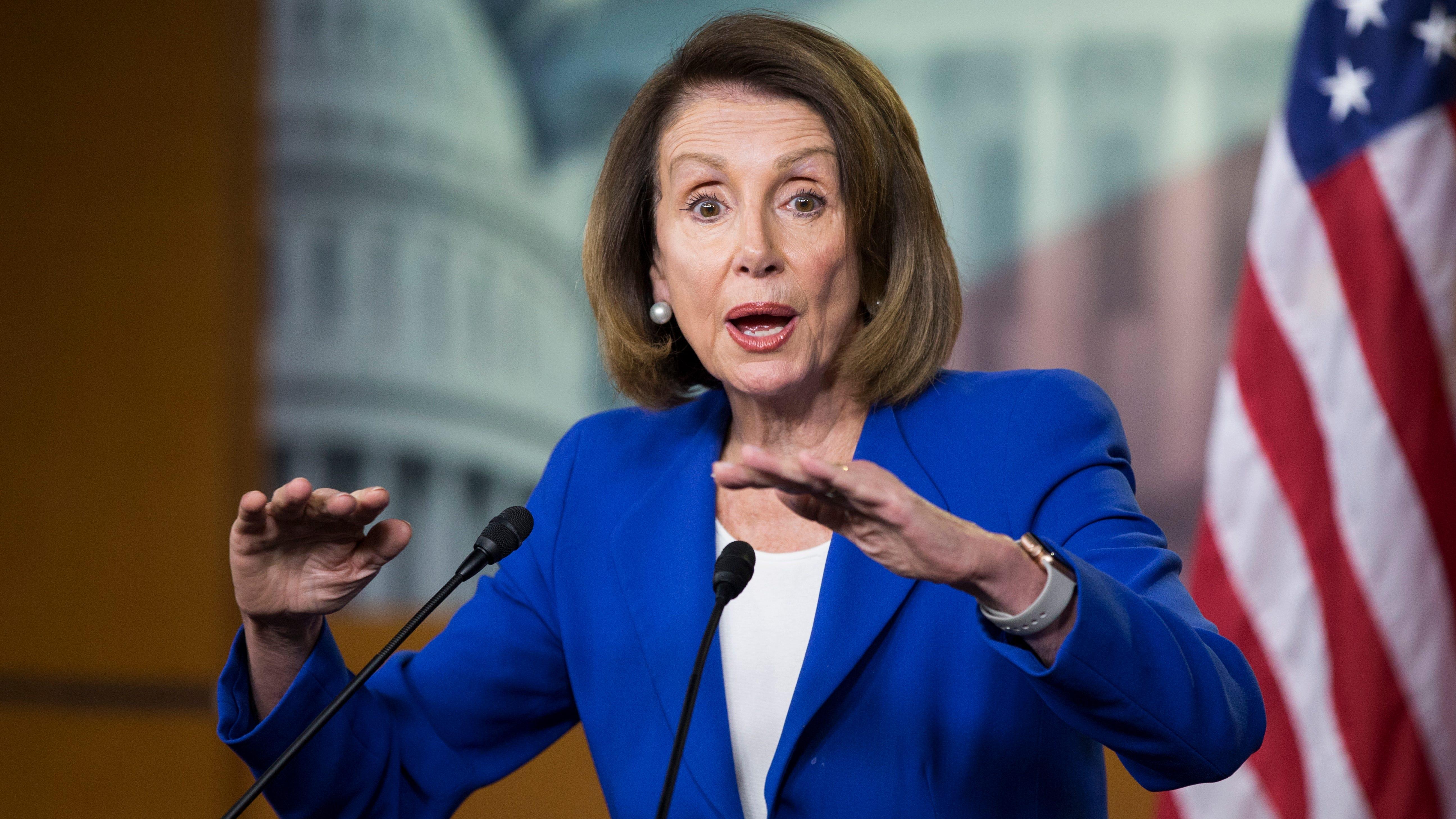 House Speaker Nancy Pelosi holds a news...