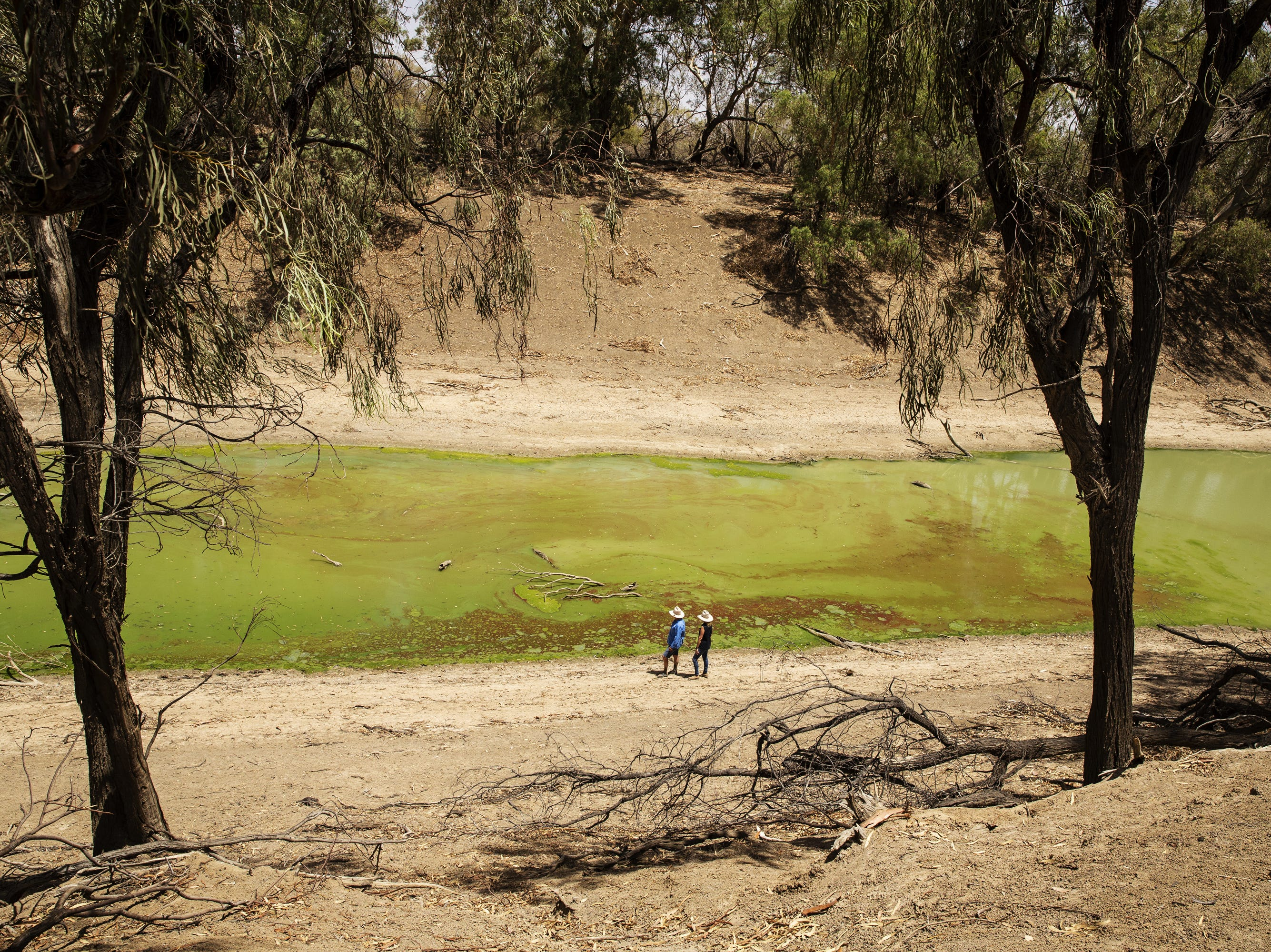 Chrissy and Bill Ashby pose for a portrait on the banks of the Darling River near their property Trevallyn Station on Jan. 16, 2019 in Tilpa, Australia. Chrissy elaborates on being able to deal with the extreme heat, the drought, the dust but is deeply concerned about getting justice in regards to the poor state of the river. Local communities in the Darling River area are facing drought and clean water shortages as debate grows over the alleged mismanagement of the Murray-Darling Basin. Recent mass kills of hundreds of thousands of fish in the Darling river have raised serious questions about the way WaterNSW is managing the lakes system, and calls for a royal commission.
