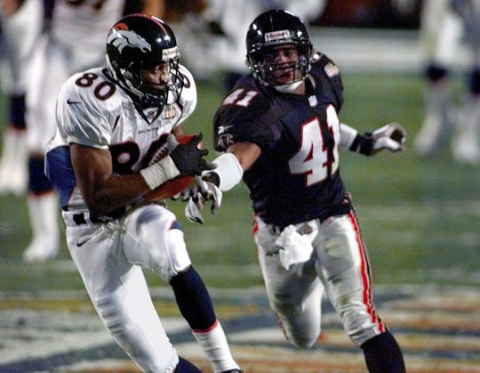 Denver Broncos wide receiver Rod Smith (80) catches a pass for a touchdown  over 62d9c796f