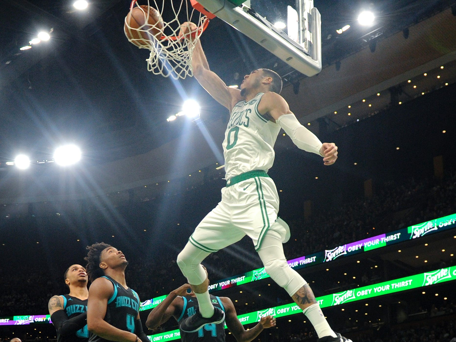 Jan. 30: Celtics forward Jayson Tatum finishes off the one-handed alley-oop against the Hornets in Boston.