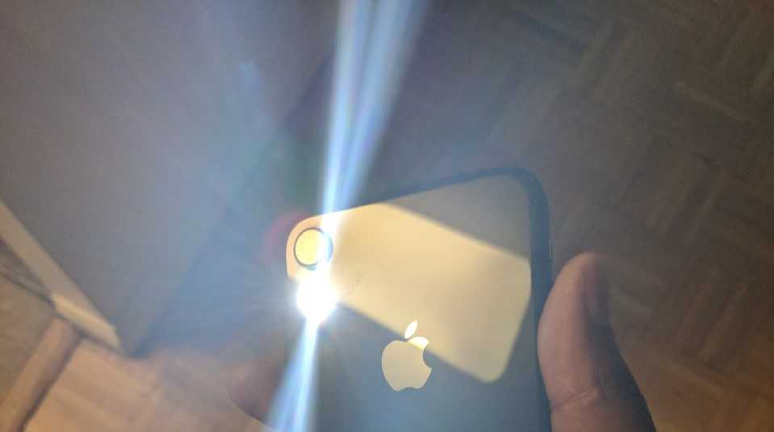 Why iPhone flashlight seems to turn itself on and how to