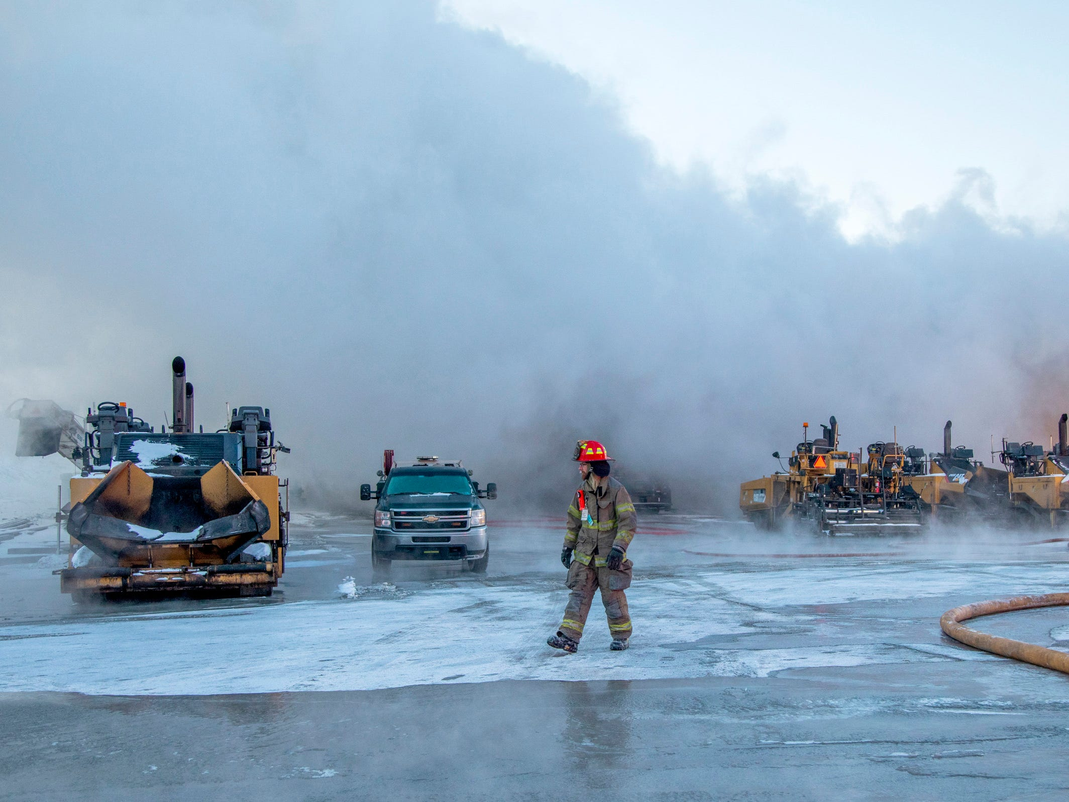 More than a dozen fire companies work at the scene of a fire at Lindy Paving warehouse, Jan. 31, 2019, in Big Beaver Township, Pa.