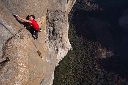 Alex Honnold free solo climbing on El Capitan's Freerider in Yosemite National Park.