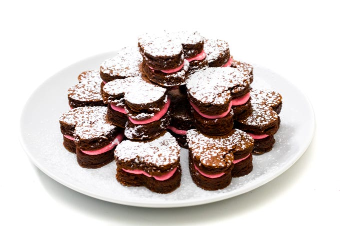Heart-shaped brownies with raspberry buttercream