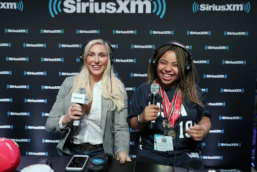 Charlotte Flair and Erykah Culbertson attend SiriusXM at Super Bowl LIII Radio Row on January 31, 2019 in Atlanta, Georgia.