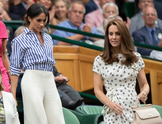 Duchess Meghan of Sussex and Duchess Kate of Cambridge at Wimbledon on July 14, 2018