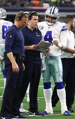 Dallas Cowboys quarterback Dak Prescott (4) and offensive coordinator Kellen Moore (middle) once competed for a job as Tony Romo's backup.