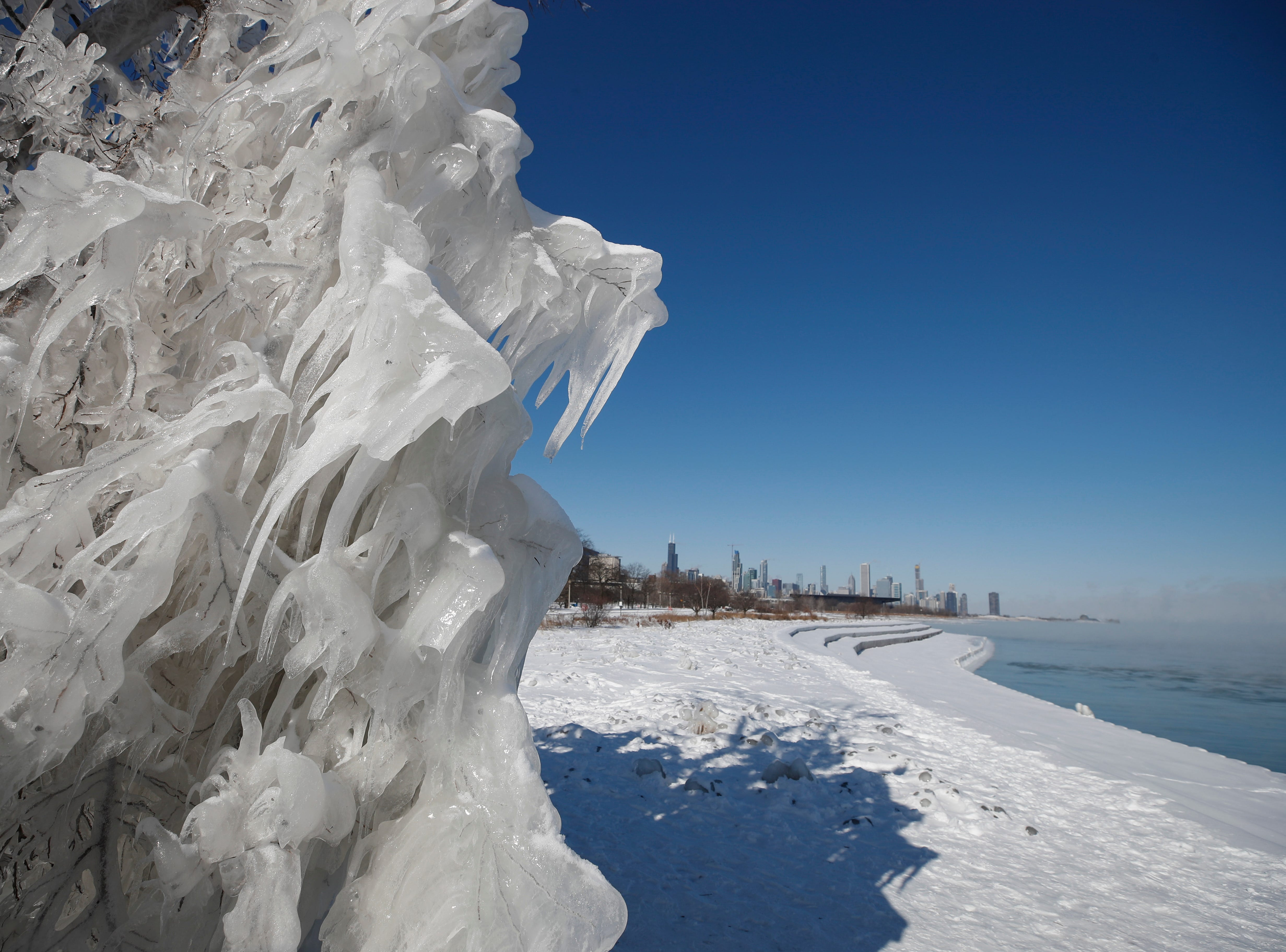 Ice and snow builds up along Lake Michigan in Chicago, Ill. on Jan. 30, 2019. The US Midwest is gripped by a cold spell as a polar vortex sent temperatures far below zero degrees Celsius. According to meteorologists temperatures in Chicago area could drop to minus 25F degrees.