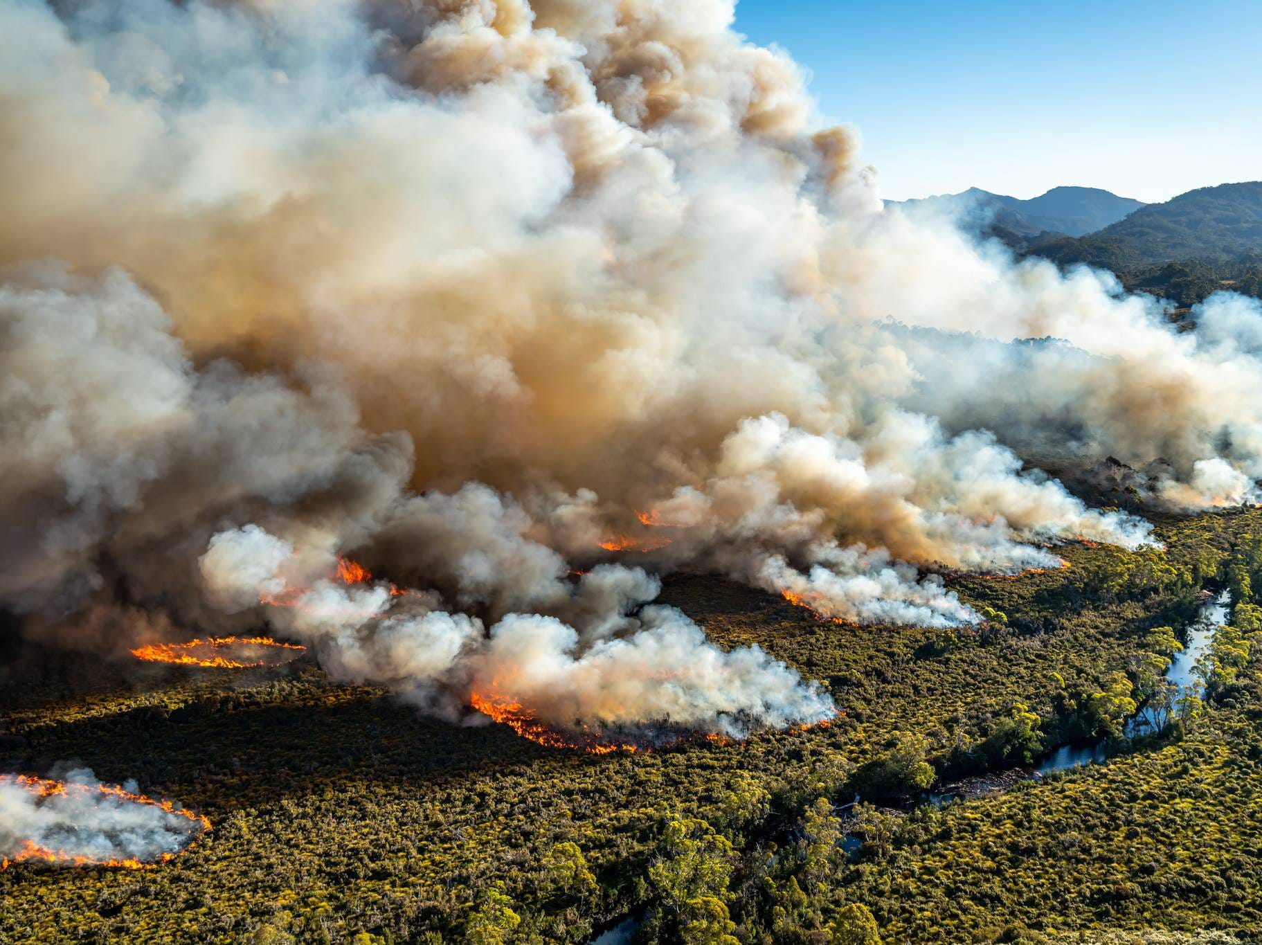 An undated handout photo made available by the Tasmania Parks and Wildlife Service on Jan. 23, 2019 shows an aerial view of a large bushfire burning in Tasmania, Australia. Some 55,0000 hectares of wilderness and bushland across the state has been ravaged by scores of fires, at least one of which has been burning since late December.