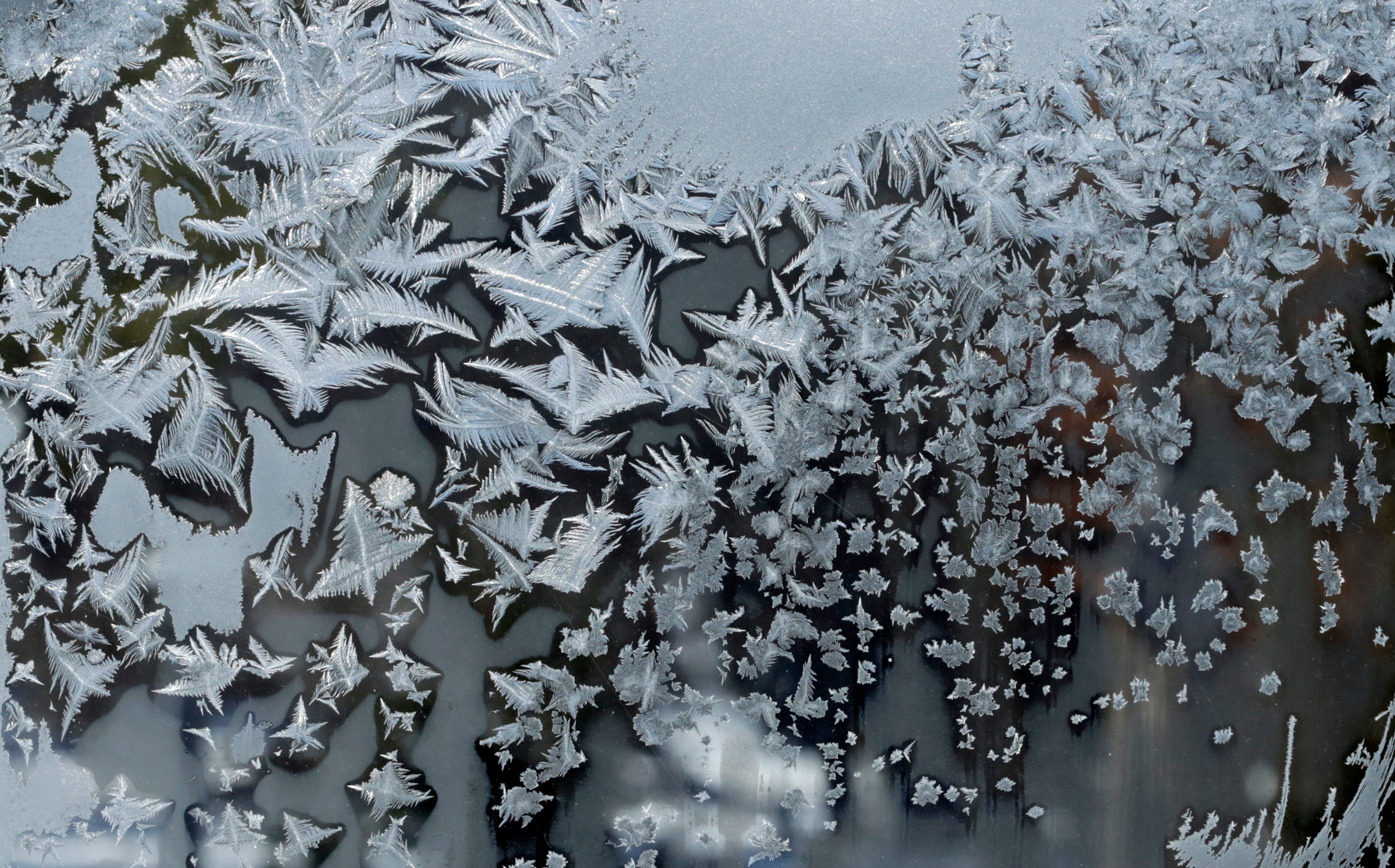 Ice Crystals form on a window Thursday, Jan. 31, 2019, in Pepper Pike, Ohio. The painfully cold weather system holding much of the Midwest in a historic deep freeze sent temperatures plunging to record low temperatures in several cities Thursday, and while a dramatic swing of as much as 80 degrees is expected by early next week, the weather system continued to wreak havoc to air travel and other infrastructure as it marched eastward.