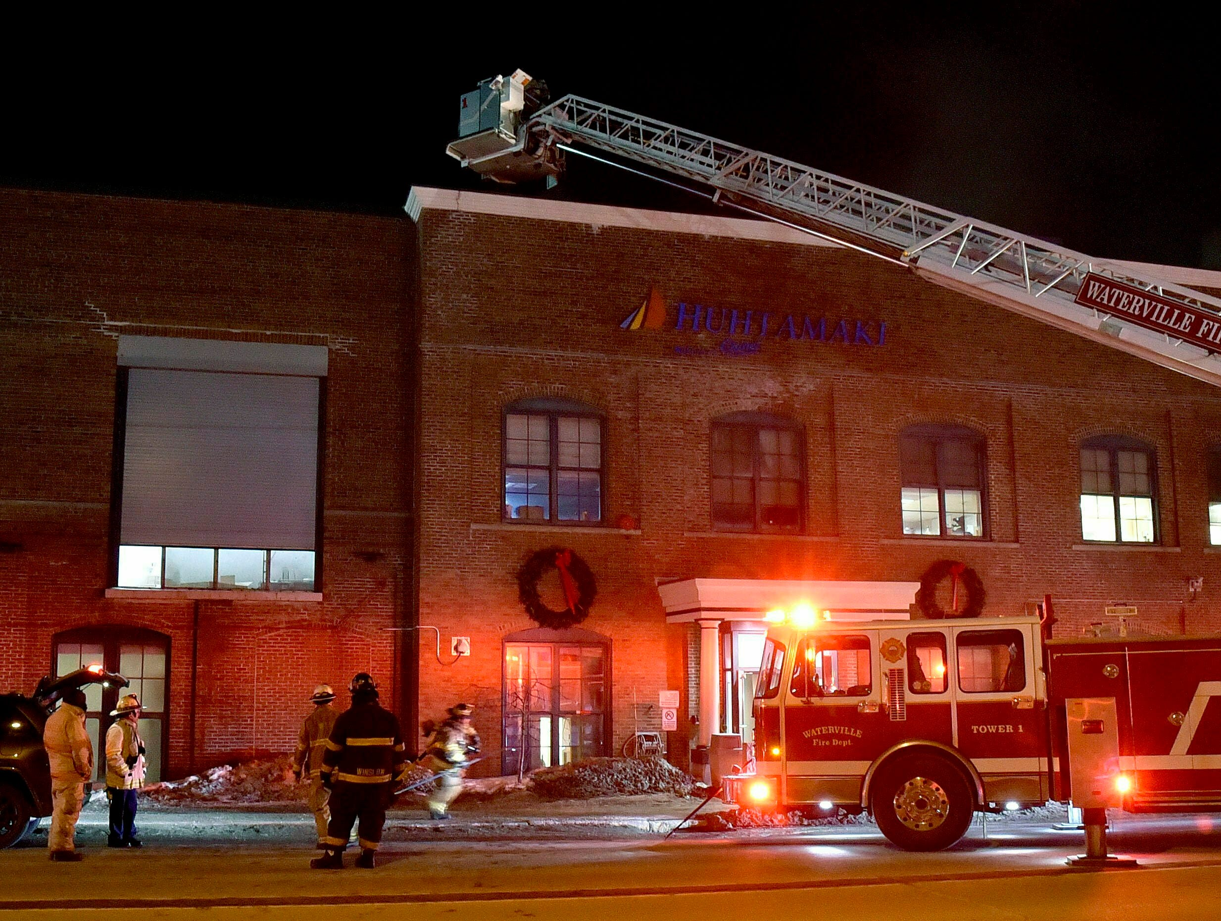 Firefighters from Waterville reach the roof of the Huhtamaki mill for a fire that had several departments responding Jan. 29, 2019 in Waterville Maine.