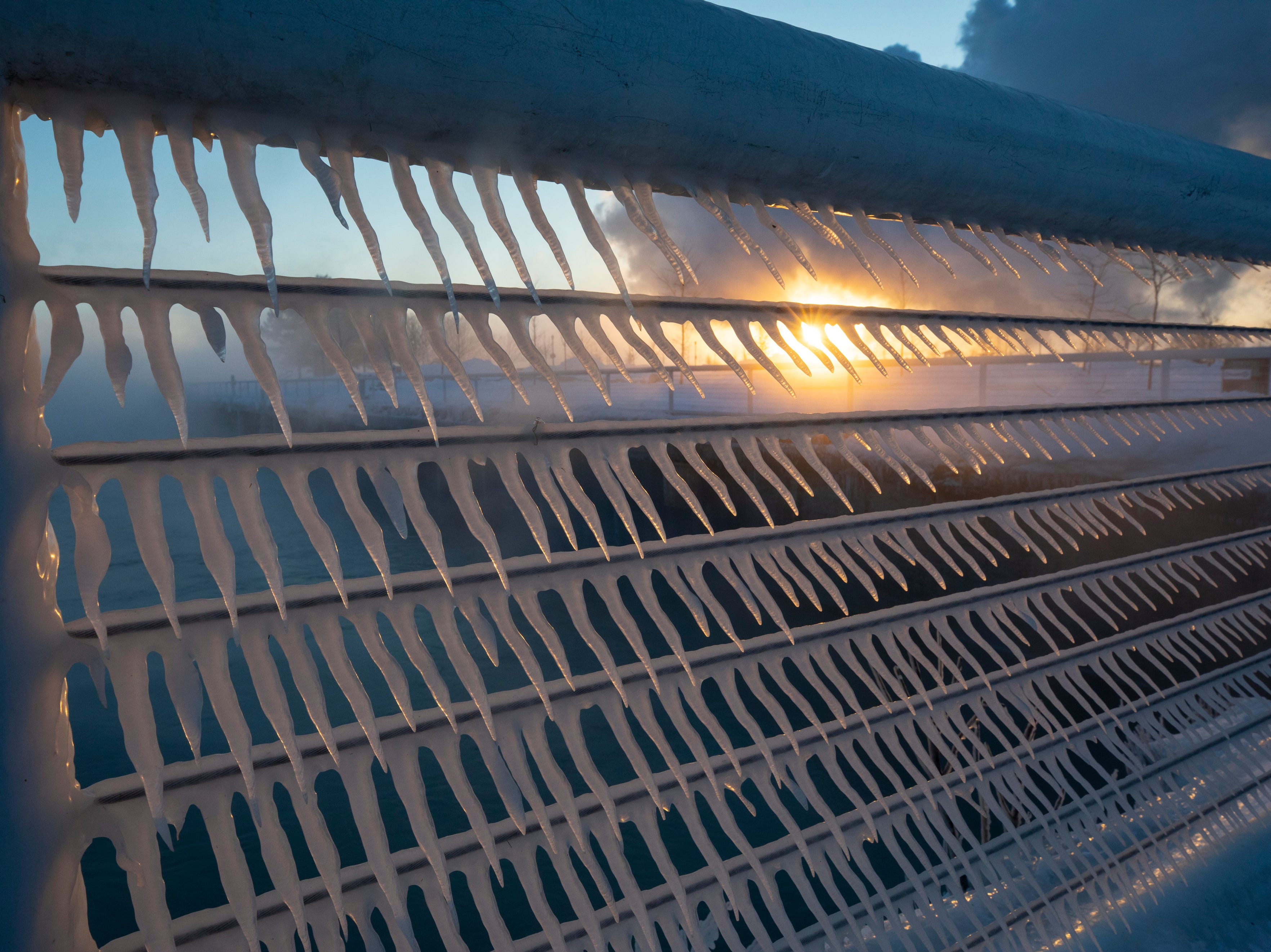 Icicles form on a railing as the sun rises in the harbor in Port Washington, Wis., on Wednesday, Jan. 30, 2019 as temperatures were -22 degrees with -50 degree wind chills.