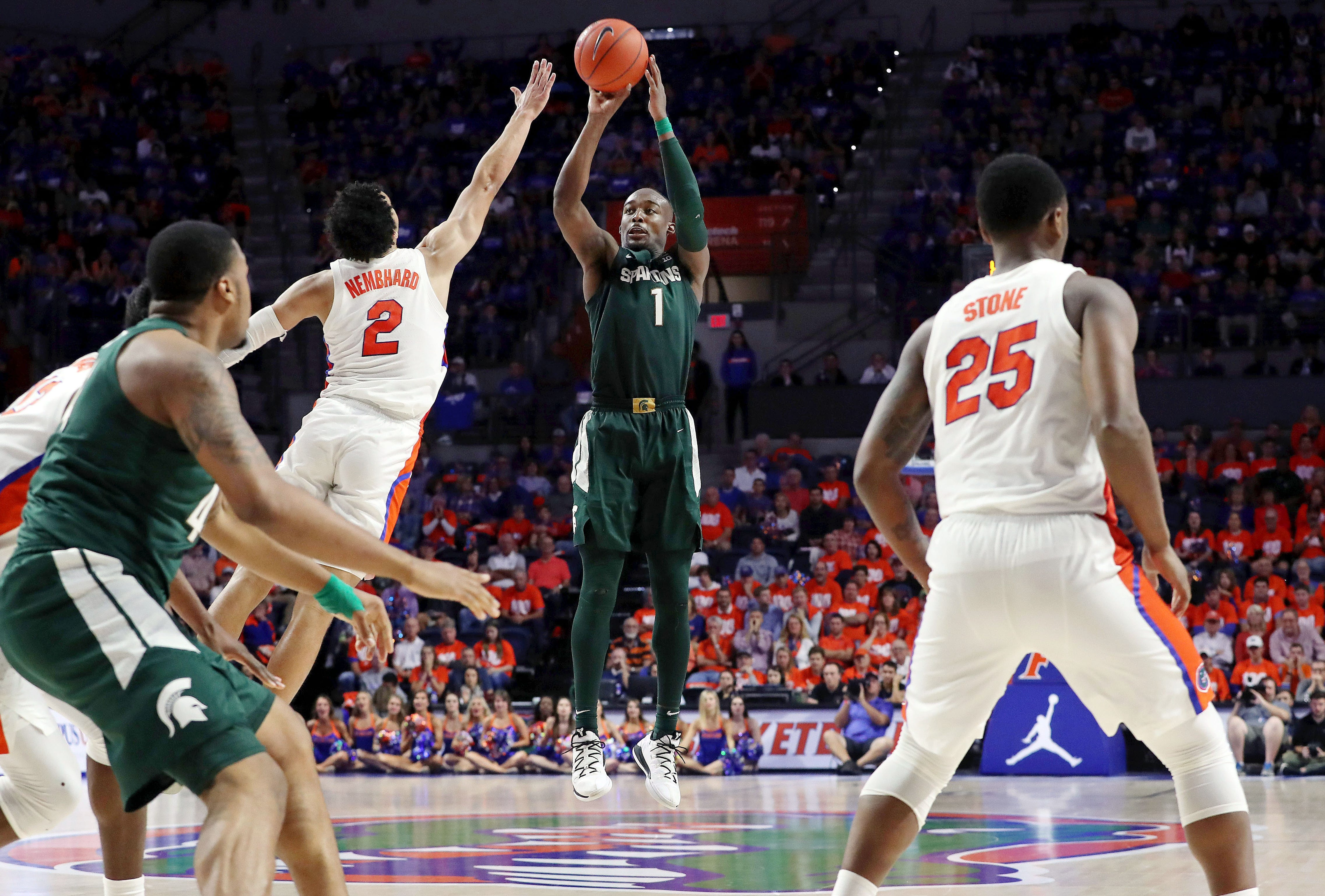 Michigan State guard Joshua Langford  shoots over Florida guard Andrew Nembhard during their game in 2018.