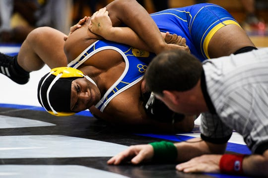 Travelers Rest's Gary Holmes III attempts to pin Berea's Justino Bonilla during the Region 2-AAAA wrestling championship at Eastside High School on Thursday, Jan. 31, 2019.