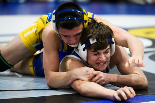 Eastside's Riley Augustine attempts to take down Bryson Mclees during the Region 2-AAAA wrestling championship at Eastside High School on Thursday, Jan. 31, 2019.