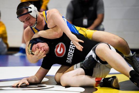 Bryson Ethington attempts to take down Greenville's Barrett Stanton during the Region 2-AAAA wrestling championship at Eastside High School on Thursday, Jan. 31, 2019.