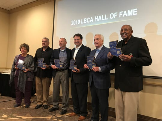 Former Pitkin baseball coach Reginald Lambright was inducted to the Louisiana Baseball Coaches Assocation Hall of Fame Jan. 12. Jeannie Lambright (left) poses with other inductees in first photo