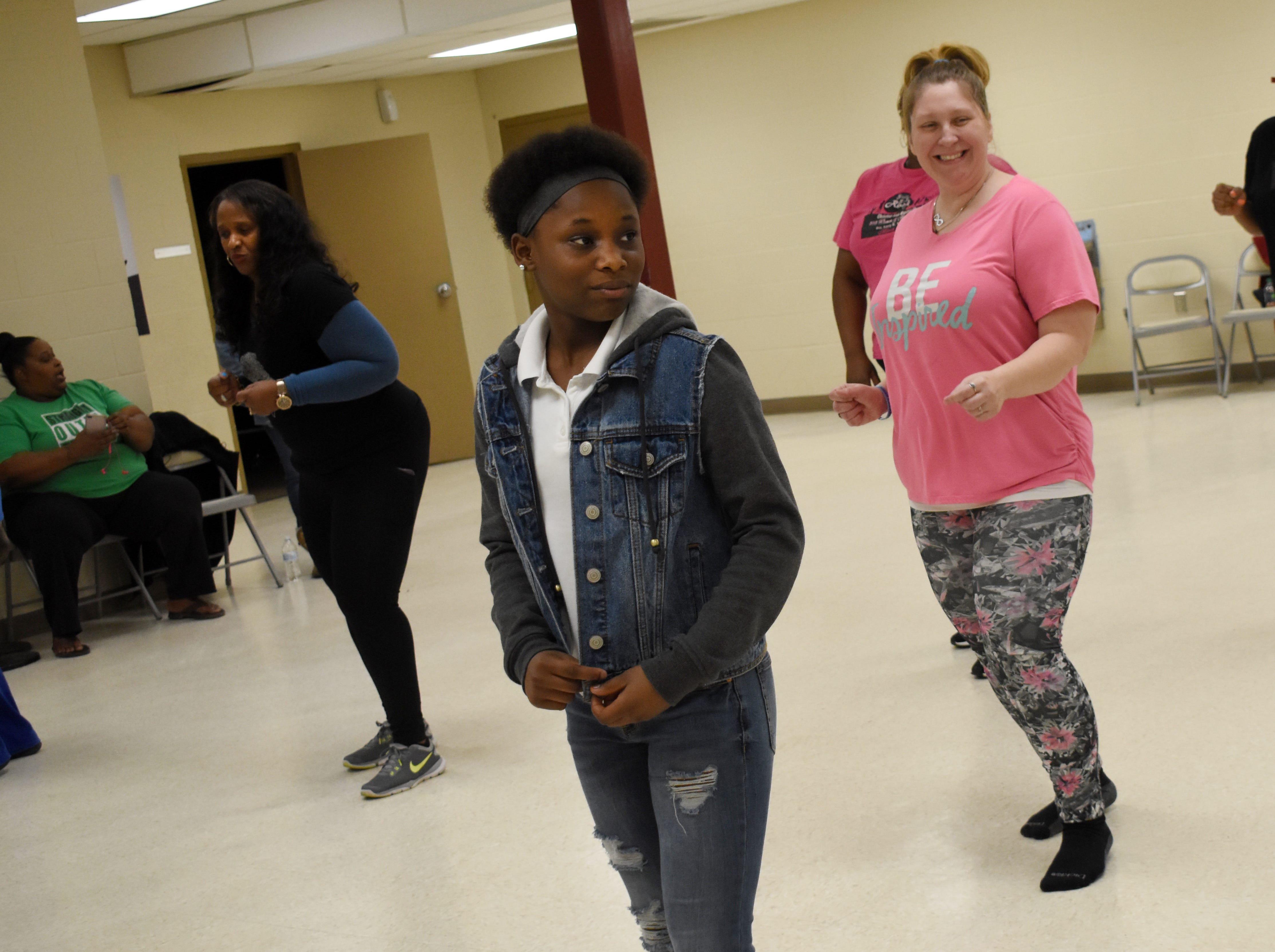 "Sheila McDaniel (back, left), Tristiny Frazier (center) and Jackie Herrmann learn line dancing from Sakena Cannon at the Alexandria Youth & Teen Center. Sakena, along with her sister Aketa Cannon, are instructing free line dancing classes at 6 p.m. every Tuesday and Thursday at the Alexandria Youth & Teen Center located in the former Boys and Girls Club on Sylvester Street. Some of the line dances Sakena and Aketa have taught so far include the ""Cleveland Shuffle,"" ""Same Ole 2 Step,"" ""Do It With Your Boots"" and the ""Mississippi Shuffle."