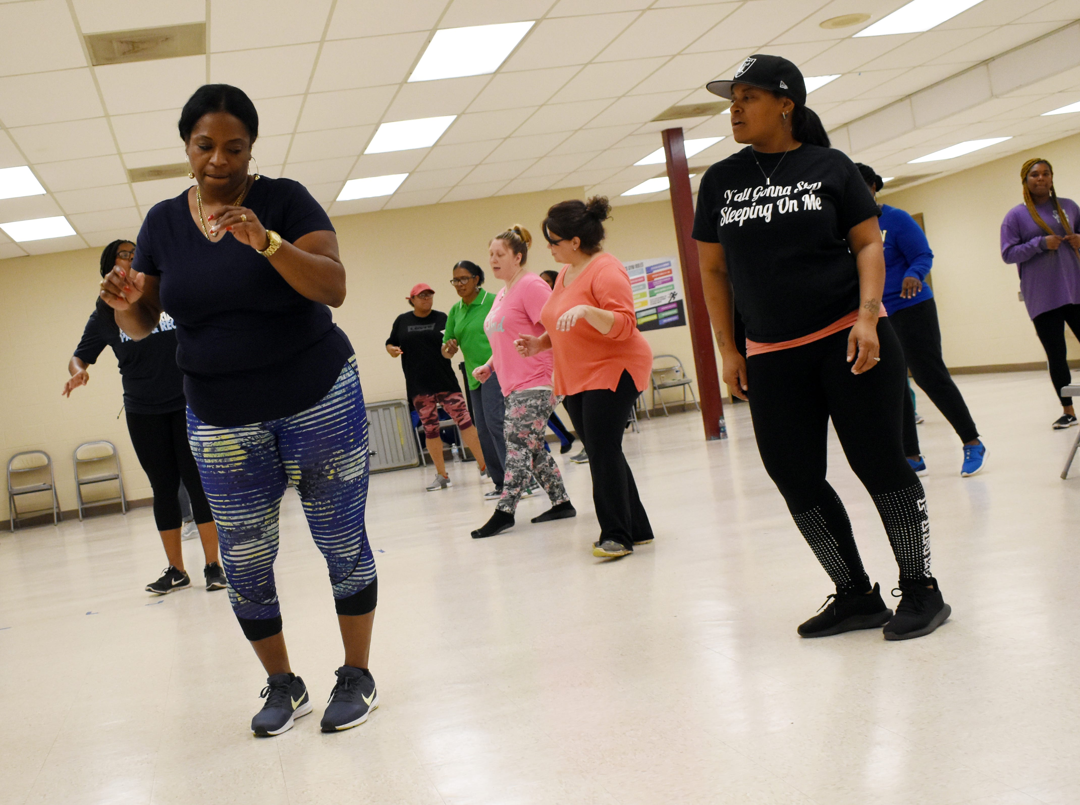 "Peggy Green (left) and Michelle Alexander line dance in a class taught by Sakena Cannon along with her sister Aketa Cannon. Sakena and Aketa are instructing free line dancing classes at 6 p.m. every Tuesday and Thursday at the Alexandria Youth & Teen Center located in the former Boys and Girls Club on Sylvester Street. Some of the line dances Sakena and Aketa have taught so far include the ""Cleveland Shuffle,"" ""Same Ole 2 Step,"" ""Do It With Your Boots"" and the ""Mississippi Shuffle."