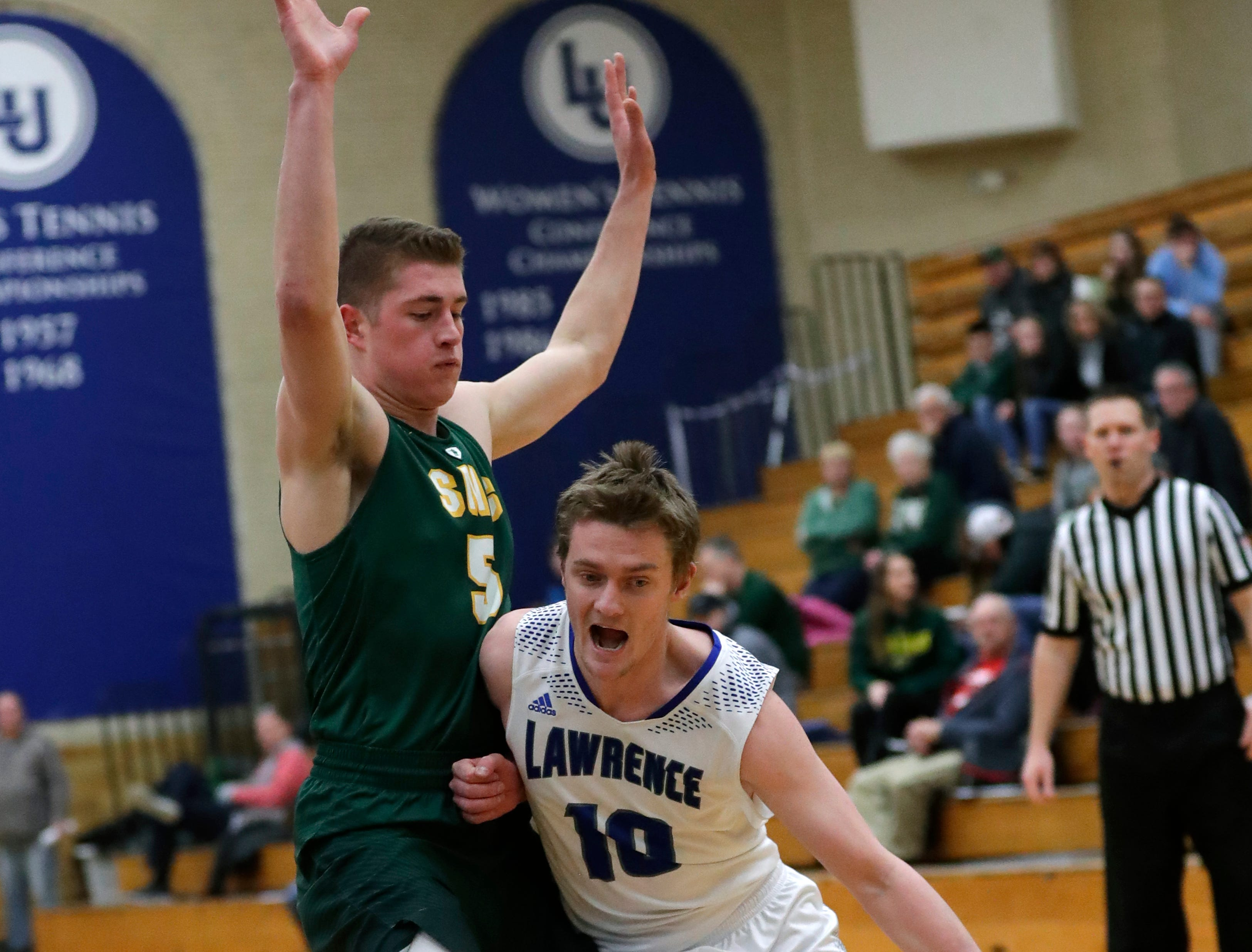 Lawrence University's Brad Sendell (10) drives to the basket against St. Norbert College's Joe Ciriacks (5) during their men's basketball game Thursday, January 31, 2019, at Alexander Gymnasium in Appleton, Wis. 